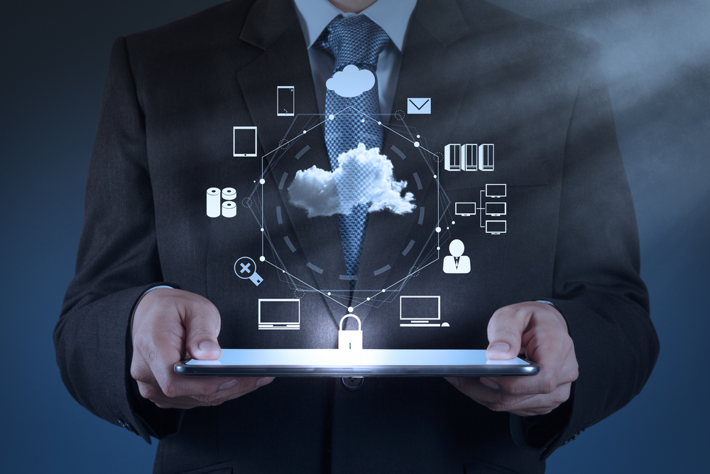 """<img src=""""professional-man-in-suit-holding-tablet-with-data-cloud-and-devices.jpeg"""" alt=""""professional-man-in-suit-holding-tablet-with-data-cloud-and-devices-looking-at-the-hybrid-work-model-across-industries"""">"""