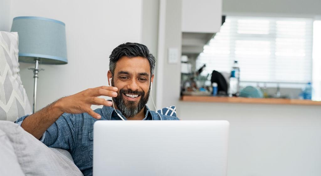 man-on-video-call-on-laptop